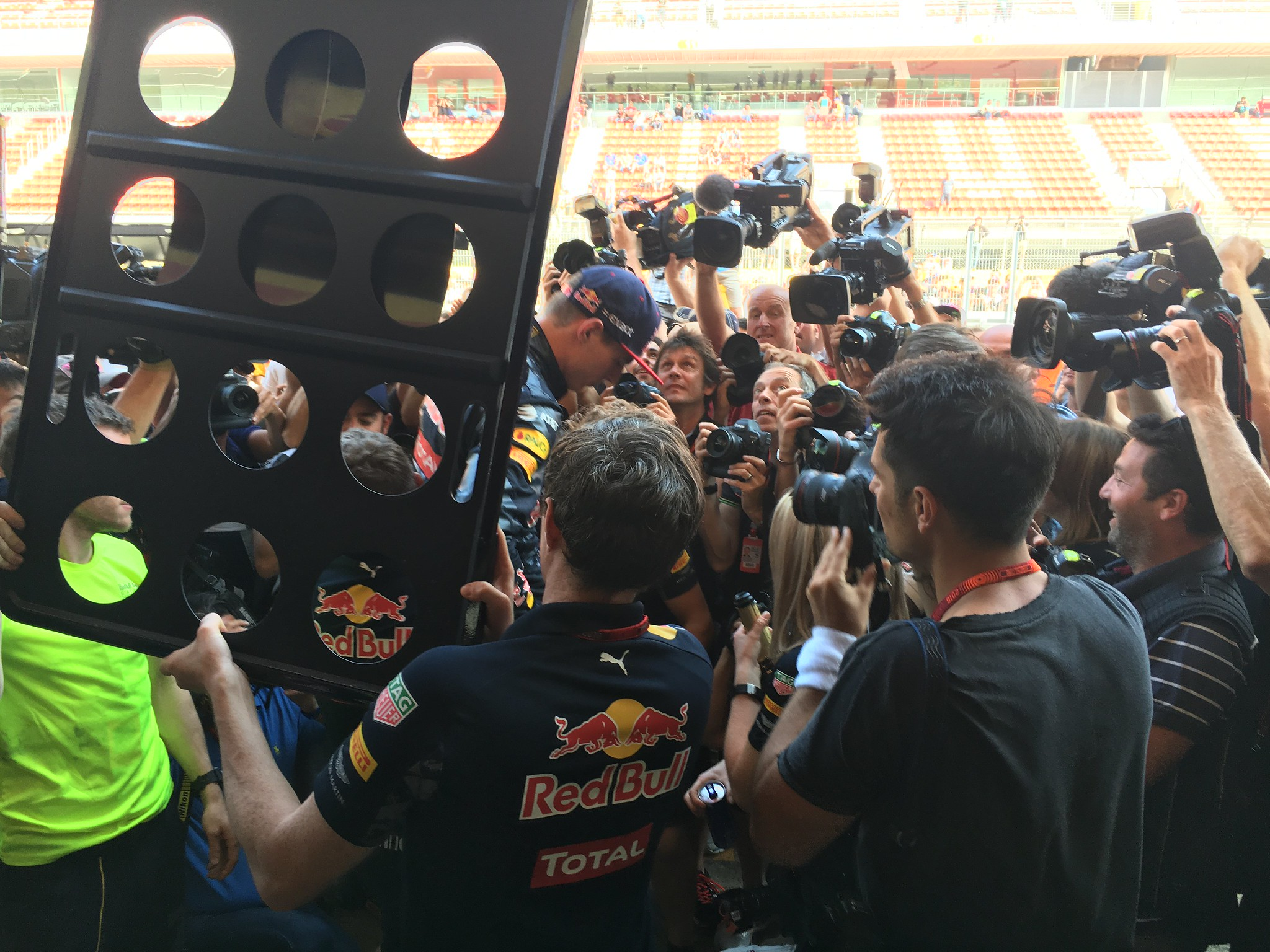 Vladimir Rys takes pictures of Max Verstappen during after race celebration